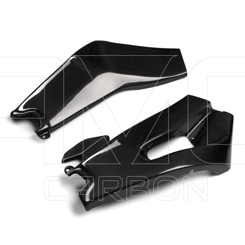 Couple of swingarm guards (glossy carbon)